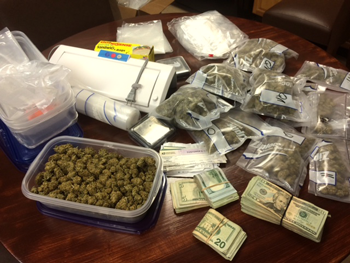 The 2,2 pounds of marijuana and $5,600 cash seized.