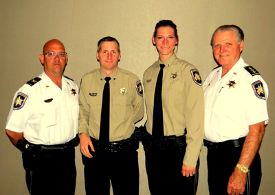 Two St. Bernard Parish sheriff's deputies graduated the P.O.S.T. basic police training academy in Slidell on April 1. Shown are, from left, Col. David Mowers, head of the Corrections Division; graduates James Manint and Dixie Dusang, both of the Corrections Division; and Chief Deputy Richard Baumy.