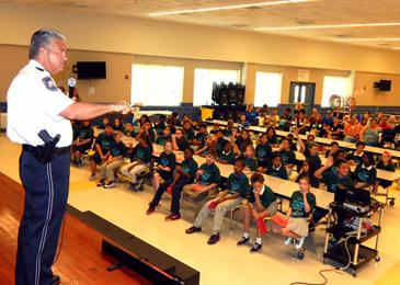 Sheriff James Pohlmann addresses D.A.R.E. graduates and parents at Chalmette Elementary.