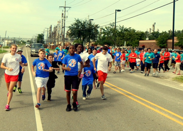Runners and walkers turn on to Paris Road from the St. Bernard Parish Prison to begin the Torch Run, which ended at Torres Park.