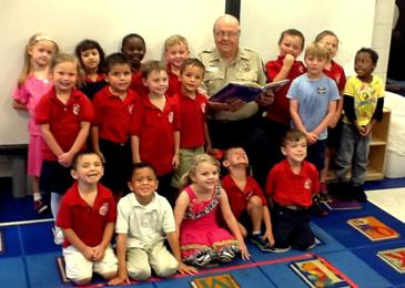 The children gather around Dep. Sheriff Lt. Billy Cure.