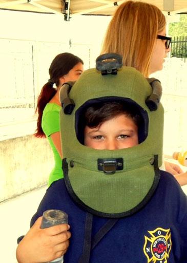 Participant Jonathan Bartholomew of Meraux wears a bomb squad helmet.
