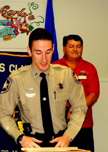 Dep. Skyler Rauch, with Sam Catalanotto of Kiwanis to the side.