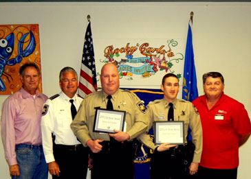 Shown receiving the St. Bernard Kiwanis Club Life-Saver Award are, third from the left and fourth from the left, respectively, deputies Scott Saigeon and Skyler Rauch. With them from left is Kiwanis President-elect Mike Gorbaty, Sheriff James Pohlmann and at right, Sam Catalanotto, chairman of the Kiwanis Life-Saver Commitee,