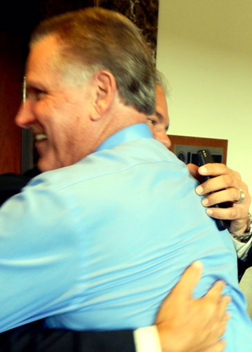 Chief Deputy Sheriff Richard Baumy, second in charge of the department under the sheriff, and the sheriff hug in the celebration.