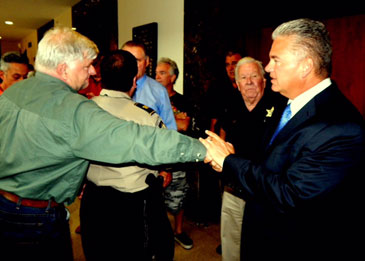 State District Judge Kirk Vaughn shakes hands with Sheriff Pohlmann