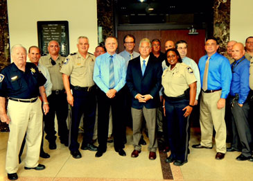 Numerous deputies gather with Sheriff Pohlmann after the victory.
