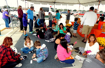 Children and parents build things and work on projects at the Kids Safety Day at Home Depot.