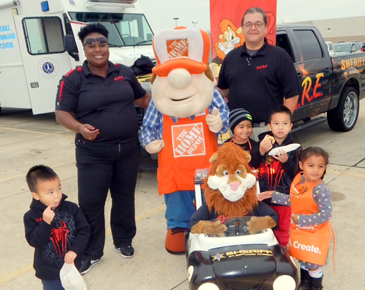 Lt. Lisa Jackson and Sgt. Darrin Miller of the D.A.R.E. drug abuse resistance program, with children and the miniature car ridden by Daren, mascot of the D.A.R.E. program.