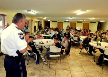 Sheriff James Pohlmann talks to a crowd of parents, children and church officials at a Pentecostal Church gathering in Chalmette for the National Night Out Against Crime.