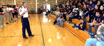 Sheriff James Pohlmann speaks to students at Trist Middle.