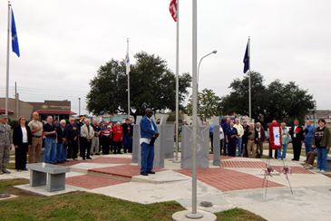 Veterans of military service gather at the St. Bernard Veterans Monument during St. Bernard Parish government's annual Veterans Recognition Ceremony.