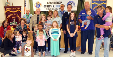 Children of the Joseph Rummel Knights of Columbus Council 5747 join in the celebration of the Deputy, Firefighter and Paramedic of the Year.