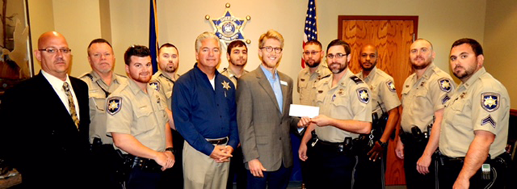 Some of the correctional officers working in Parish Prison involved in growing a beard to help raise $2,700 for the American Cancer Association are shown at a ceremony Monday where a check was given to Alexander Hand of the American Cancer Society in New Orleans. Shown in front, from left to right, are Col David Mowers, head of the Corrections Division; Dep. Christopher Manno, Sheriff James Pohlmann, Alexander Hand, Lt. Justin Meyers who is holding the check and Cpl. Jeff Babin. In back are Dep. Frank Auderer, Dep. Robert Maloz, Dep. Richard Chauppetta, Sgt. Emile Breaux, Dep. Timothy Williams and Cpl. Wayne Babin.