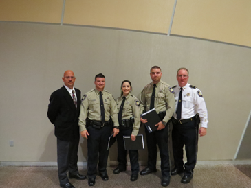 Three sheriff's deputies graduated a P.O.S.T. police academy on Nov. 6, including, from second to left, Christopher Manno Jr., Rosalyn Cantrell and Kyle Brown. Flanking them are, at left, Col. David Mowers, head of the Correctioins Division; and at right, Maj. David DiMaggio, head of training.
