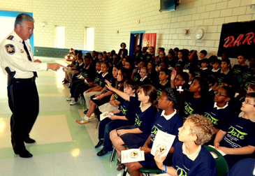 Sheriff James Pohlmann speaks to students at Arabi Elementary.