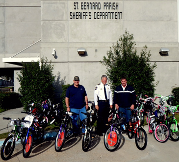 The 20 bicycles donated by Associated Terminals are shown as Sheriff James Pohlmann stands with Jason Perez, right, operations manager at Associated Terminals, and Louis Fos, left, its cranes manager.