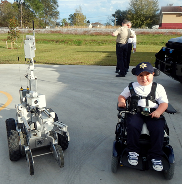 Trever checks out the Sheriff's Office bomb robot used to investigate suspicious items.