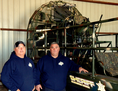Capt. Brian Clark, left, and Cpl. Shane Lulei, both of the Sheriff's Office Marine Division, stand next to an airboat used for search and rescue.