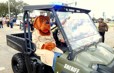 McGruff the Crime Dog, portrayed by Greer Cuccia of the Sheriff;s Office, in the parade.
