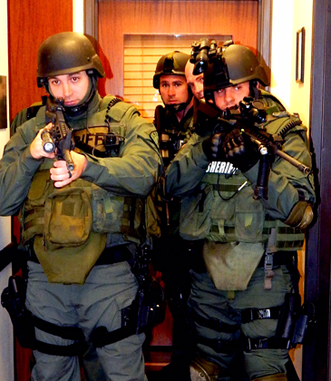 Officers in a corridor between offices in the Courthouse.