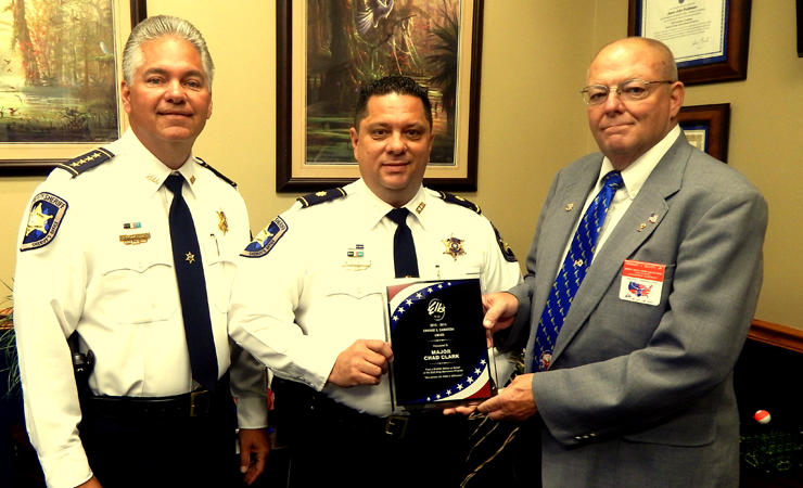 """Maj. Chad Clark receives the statewide Enrique  """"Kiki"""" Camarena Award for drug-fighting from, at right, Armand Buuck of the Benevolent and Protective Order of Elks. At left is Sheriff James Pohlmann."""