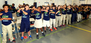 Davies students perform a D.A.R.E. song for their parents and relatives.
