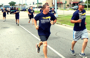 Participants in the Torch Run on Jean Lafitte Parkway.