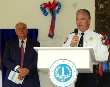 Sheriff James Pohlmann speaks during the dedication and at left is Anthony Fernandez, who organized the event.
