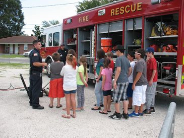 Junior Deputy Academy participants get to see the Fire Rescue truck,  its equipment and hear explanation of what it is used for.