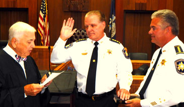 Chief Deputy Sheriff Richard Baumy is sworn-in by Judge Klees, with Sheriff Pohlmann next to him.
