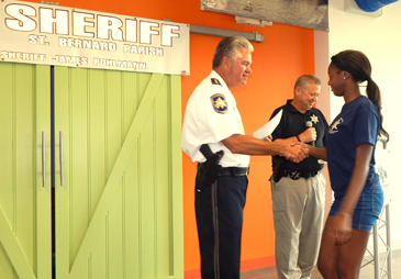 Dajahae' Robinson receives her graduation certificate from Sheriff Pohlmann.