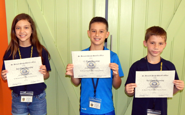 Winners of the shooting competition were, from left, Ava Chalona, second place; Lestat Buras, first place; and Christian Robin, third place.