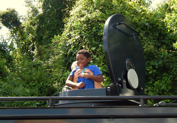 Capt. Bret Bowen lifts a child through the hatch of the S.W.A.T. truck.
