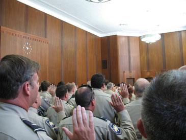 More officers sworn in.