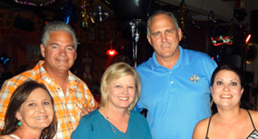 From left are Sue Murphy and Kelly Devenport , both of the Sheriff's Office, with Melissa Lane of parish government, at the fundraiser at Katz Lounge. In back are Sheriff James Pohlmann and Parish President Guy McInnis.