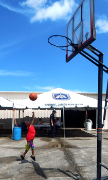 Jefferie Douglas, 7, shoots baskets during the event.