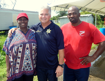 Sheriff Pohlmann is flanked by Justice of the Peace Barbara Manuel and Pastor Rodney Jiles.