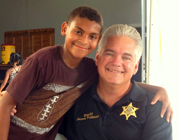 A child hugs Sheriff James Pohlmann.