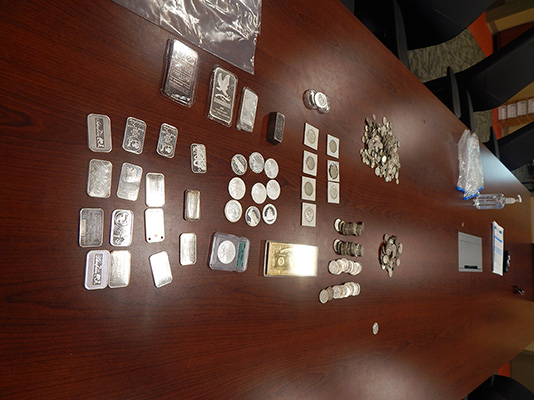 Silver coins and bars Johnson tried to sell or had in his vehicle.