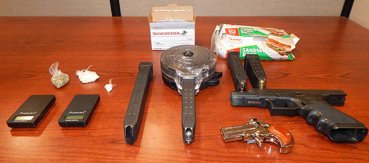 Drugs, guns and other items recovered in the arrest of Colbert.