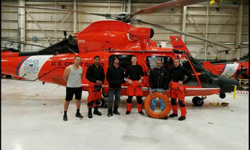 Daniel Scott and Joseph Mitchell with Coast Guard helicopter crew that rescued them.