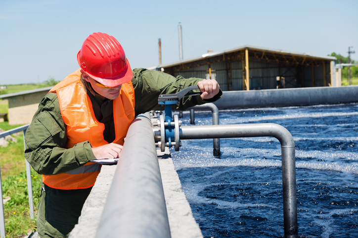 An engineer controlling the quality of water