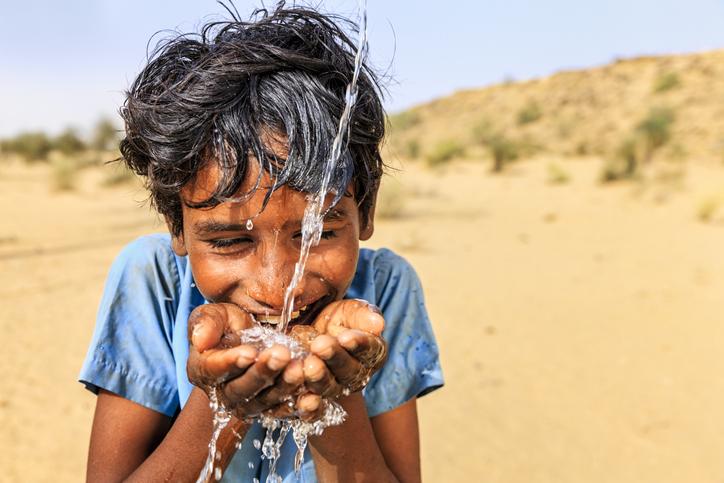 Boy drinking fresh water