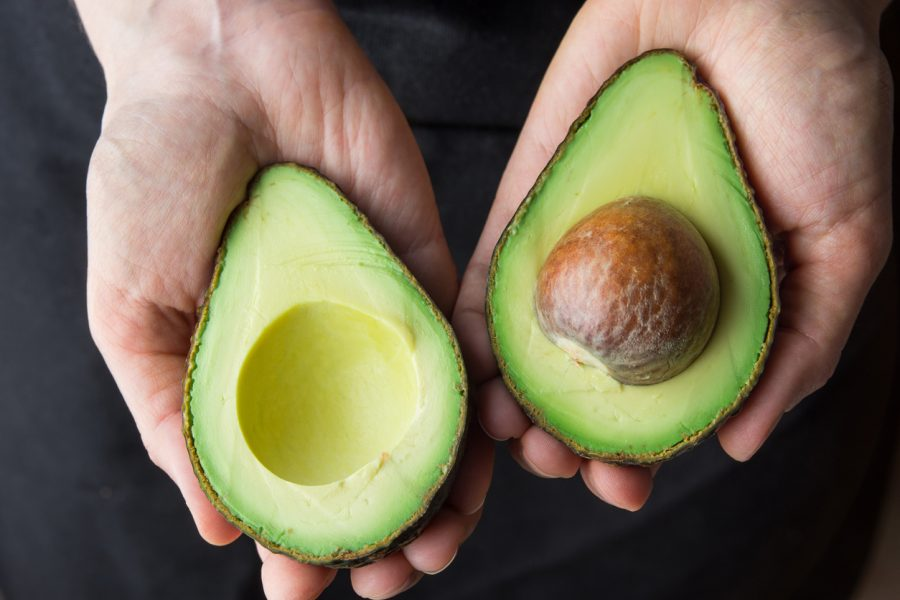 Avocado cut in half with seed