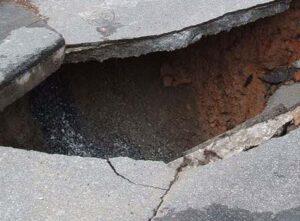 Sinkhole in Concrete Road
