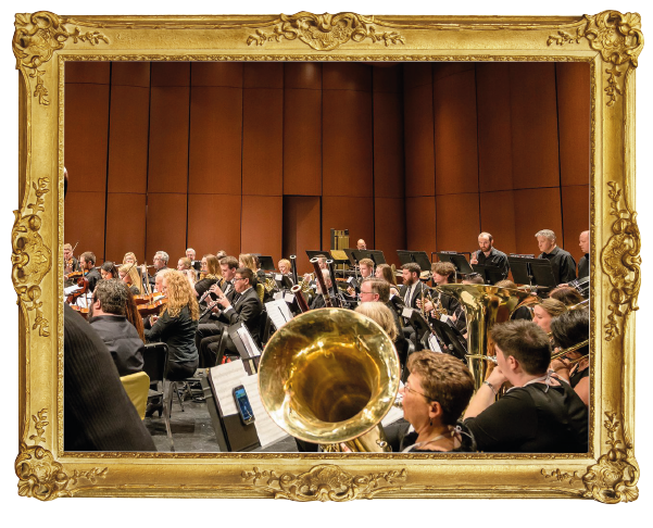Orchestra playing in gold frame
