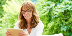 image of woman holding tablet