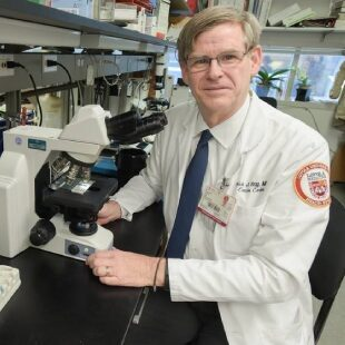 Dr. Stiff of Loyola University working in his lab