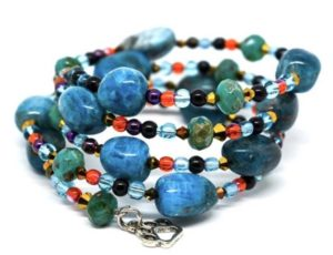 Turquoise colored stones with black, red, and gold accent beads